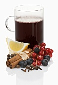 Mulled wine with berries, spices and lemon