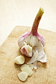 Garlic bulb and clove of garlic, partly sliced