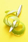 Green apple peel with knife