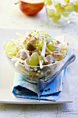 Poultry salad with fruit in glass bowl