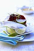 Turbot fillet with lime wedges
