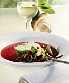 Fish consommé with beetroot and halibut roulade