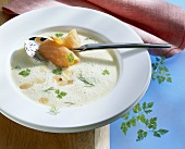 Fennel soup with salmon, chervil and flaked almonds