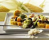 Vegetable stew with corn cob slices and horseradish