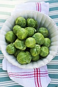 Brussels sprouts in white dish (overhead view)