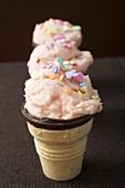Strawberry ice cream cones in a row