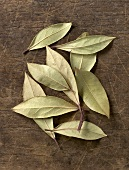 Bay leaves on wooden background