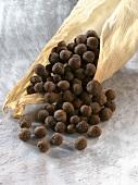 Allspice berries in a dried maize leaf