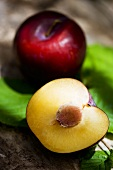 Red plums, whole and halved
