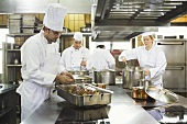 Chefs at work in a commercial kitchen
