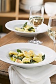 Gnocchi with sage butter, glasses of white wine