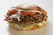 Döner sandwich with onions, tomatoes and yoghurt sauce