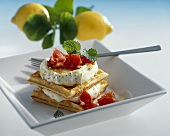Waffles with lemon soft cheese and tomatoes