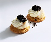Scallops and caviar on crackers