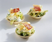 American salad in shortcrust pastry shells