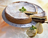 Pear and poppy seed cheesecake, a slice cut