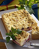 Cheesecake with berries and crumble topping, pieces cut