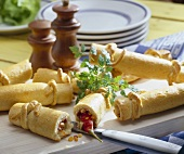 Yeast dough crackers with savoury filling