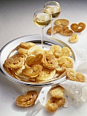 Pig's ear pastries (puff pastry) with two glasses of wine