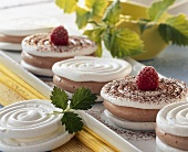 Meringues with chocolate cream and raspberries