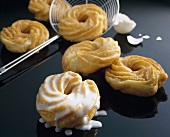 Spritzkuchen (deep-fried choux pastry rings) with icing