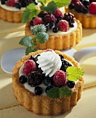 Small berry flans with vanilla cream and lemon balm