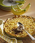 Banana and honey tart with a spoonful of cream