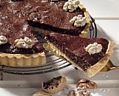 Chocolate walnut tart, a slice cut