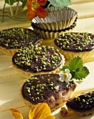 Marzipan strawberry tarts with chocolate icing