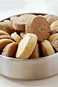 Cocoa and vanilla biscuits in biscuit tin