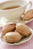 Macaroons filled with rose jam, with tea