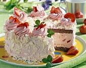 Strawberry ice cream cake, a piece taken