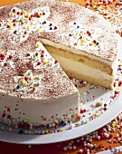 Cheese cream cake with Grand Marnier and sprinkles