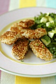 Sesame nuggets with courgettes