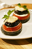 Baked aubergine, tomato and cheese towers