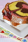 Two slices of three-coloured marble cake for child's birthday