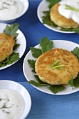 Crispy potato cakes with parsley and yoghurt sauce