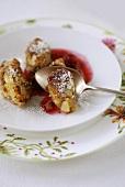 Sweet dumplings with fruit sauce