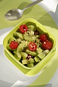 Kiwi fruit and raspberry salad with sesame seeds and honey
