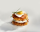 Rosti with cream cheese, bacon and quail's egg