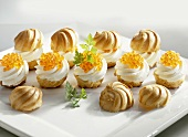 Profiteroles filled with soft cheese and trout caviar