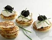 Blinis with soft cheese and caviar