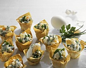 Vegetable salad with boiled egg in filo pastry shells