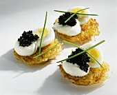 Potato rosti topped with quails' eggs, caviar & sour cream