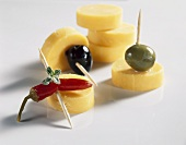 Cheese rounds with olives and chilli