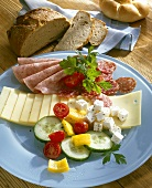 Sausage, cheese and vegetables on plate for hearty snack