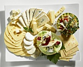 Cheese platter with salad and honeydew melon