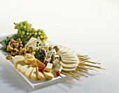 Cheese platter with biscuits and grapes