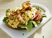 Bread topped with scrambled egg, prawns, tomatoes & bacon