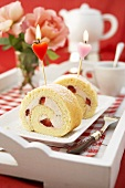 Sponge roll with strawberry filling and two candles